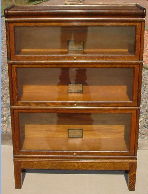 It doesn't have locking panes but could be modified. You'd probably have to  replace the glass with tempered on just about any bookcase. - Locking Storage For Coins That Allow Display - Coin Community Forum