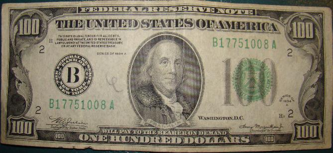 What does the new one hundred dollar bill look like