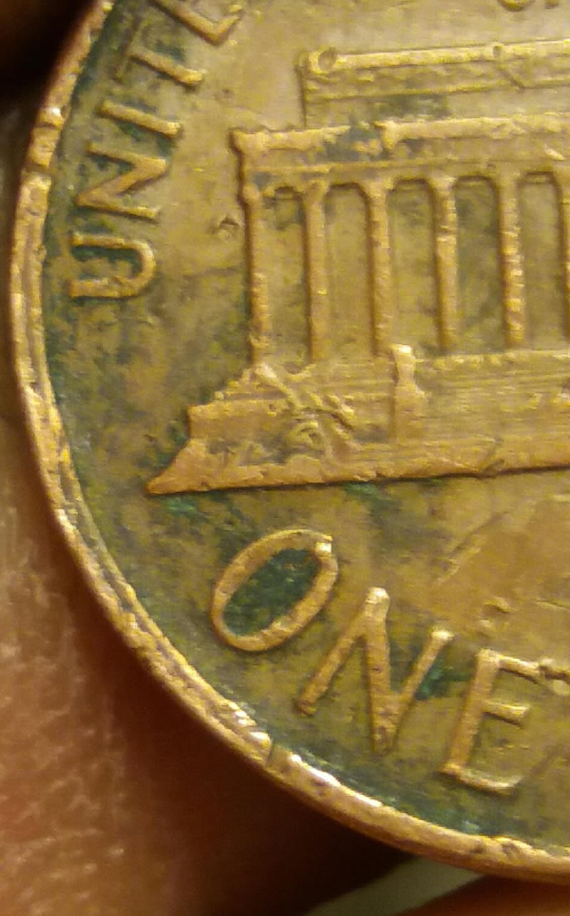 1964 penny no mint mark  The O in