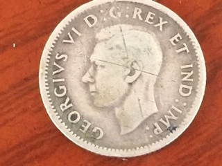 This Canadian 1943 Ten Cents coin has a die break  - Coin