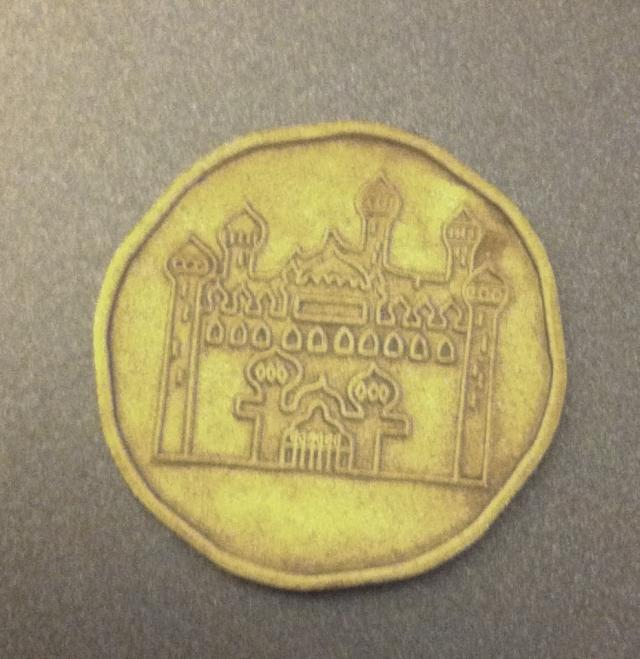 coin with a castle on it